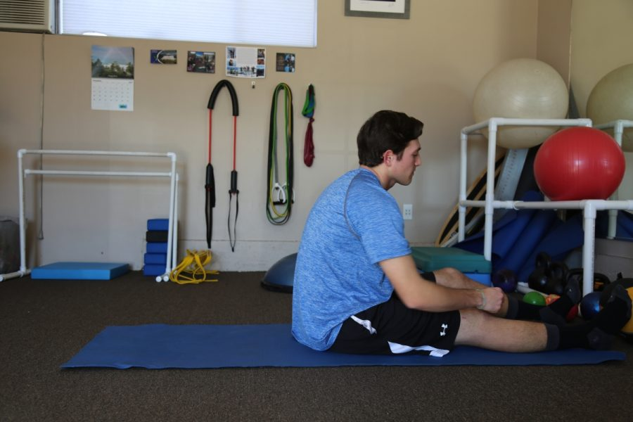 Chris+Saiki+rests+in+between+physical+therapy+exercises.