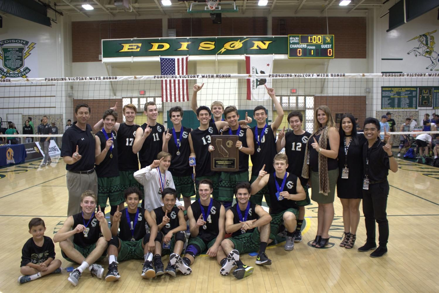 The+Boys+2017+Varsity+Volleyball+team+proudly+displays+their+state+championship+trophy+and+medals