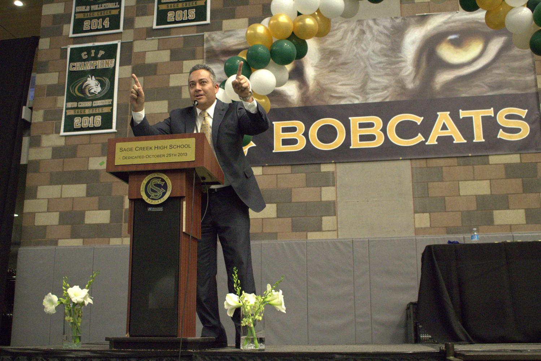 Principal Cesar Morales greets the festive crowd on senior awards night.