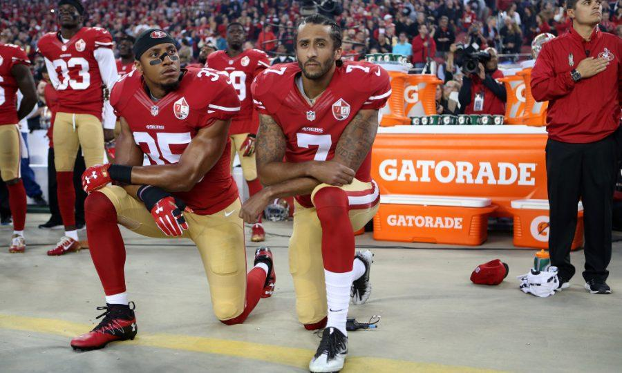 San Francisco 49ers Eric Reid (35) and Colin Kaepernick (7) take a knee during the National Anthem prior to their season opener against the Los Angeles Rams during an NFL football game Monday, Sept. 12, 2016, in Santa Clara, CA. The Niners won 28-0. (Daniel Gluskoter/AP Images for Panini) ORG XMIT: DGCA101