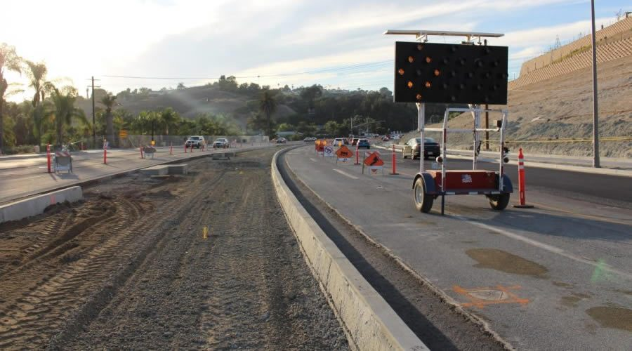 Photographer: Patrick Hanlon  Oncoming traffic makes the best of their space as the construction comes to a close