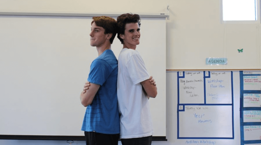 Photographer: Bailey Moncrief  Senior, Skyler Beckett (left) and junior, Jeff Wattner (right) stand back-to-back in a comedic pose. They will be the hosts of Café Bobcat