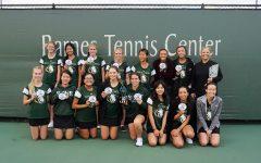 Photographer: Elijah Kinnell  Sage Creek's Varsity Girl's Tennis Team huddles together for a group photo.