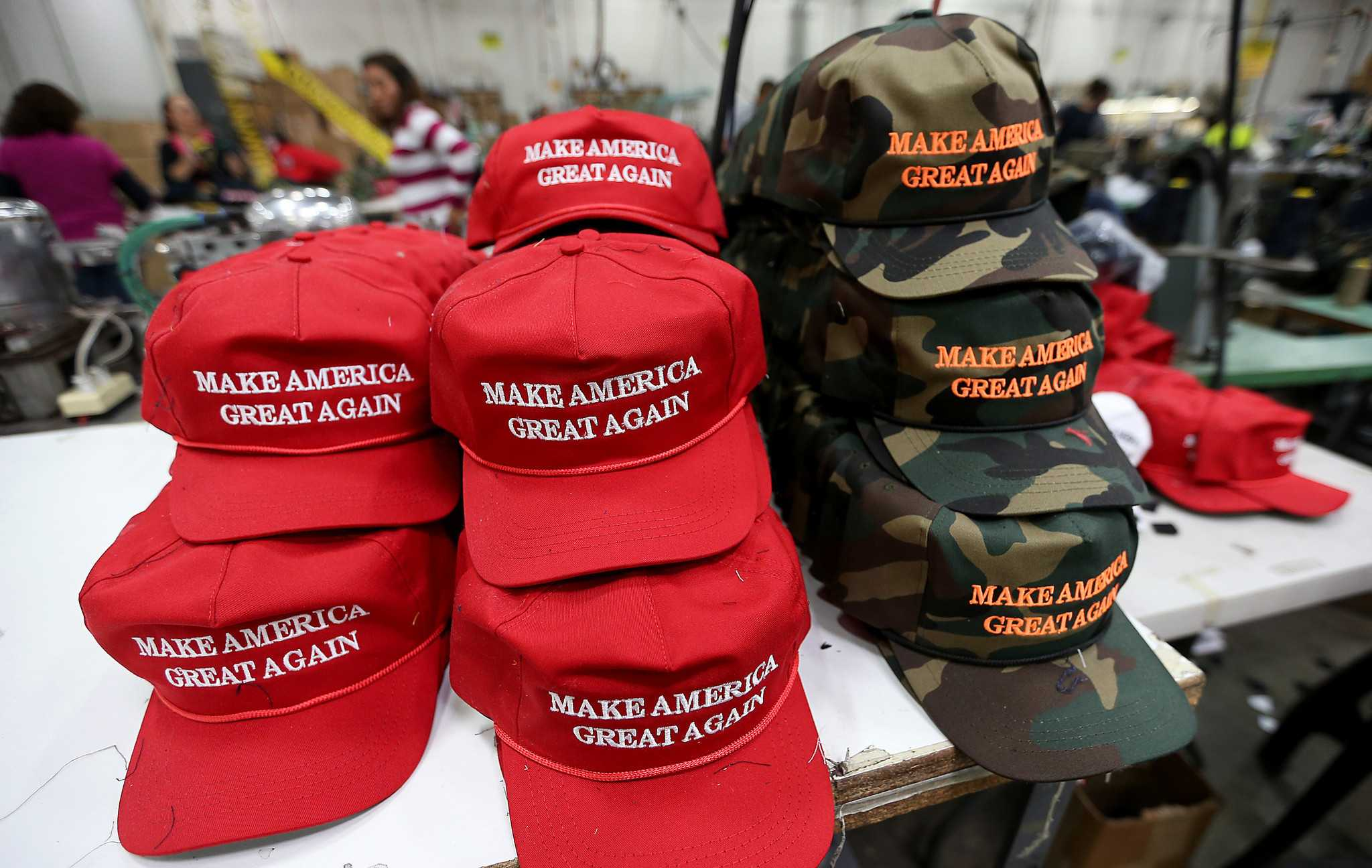 A stack of newly minted Trump campaign hats sit at the end of a production line. (Luis Sinco - The Los Angeles Times)
