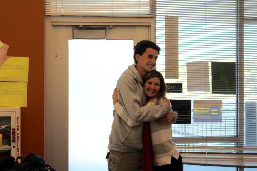 Senior Teiyler Scott and Mrs. Myers embrace.