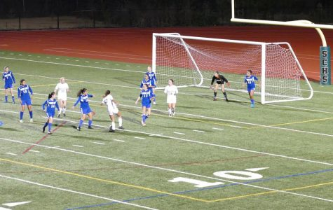 Isabel Sloss #17 with the ball at her feet in the middle of a set piece play.  Photo courtesy of Joe Zueck