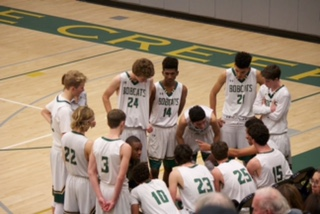 The Varsity squad gathers before the start of the fourth quarter to prepare for the tie-breaking quarter.