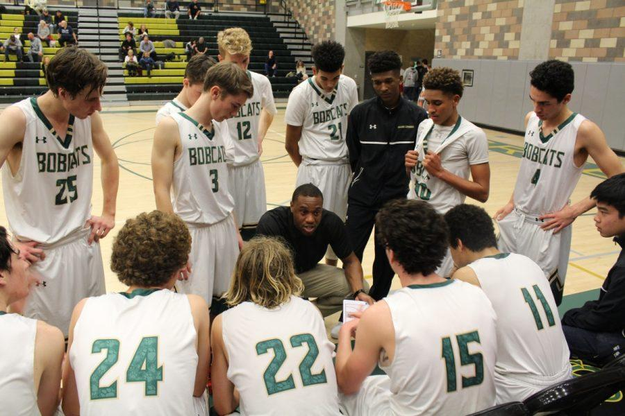 Bobcat players meet during a timeout to strategize for the fourth quarter.