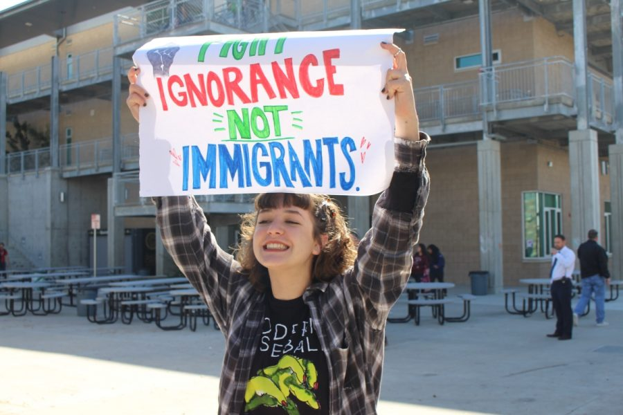Sophomore, Skylar Johnson, carries a sign that says, Fight ignorance, not immigrants.