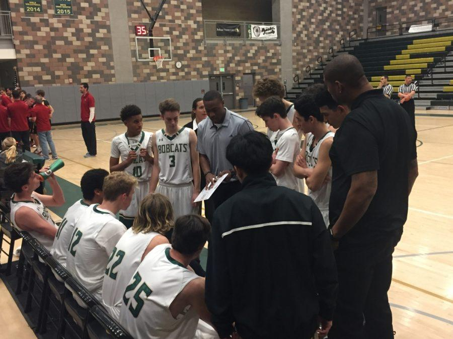 Coach+Brandon+Dowdy+rallies+his+team+in+a+meeting+during+a+high+scoring+fourth+quarter+in+the+loss+against+Torrey+Pines.