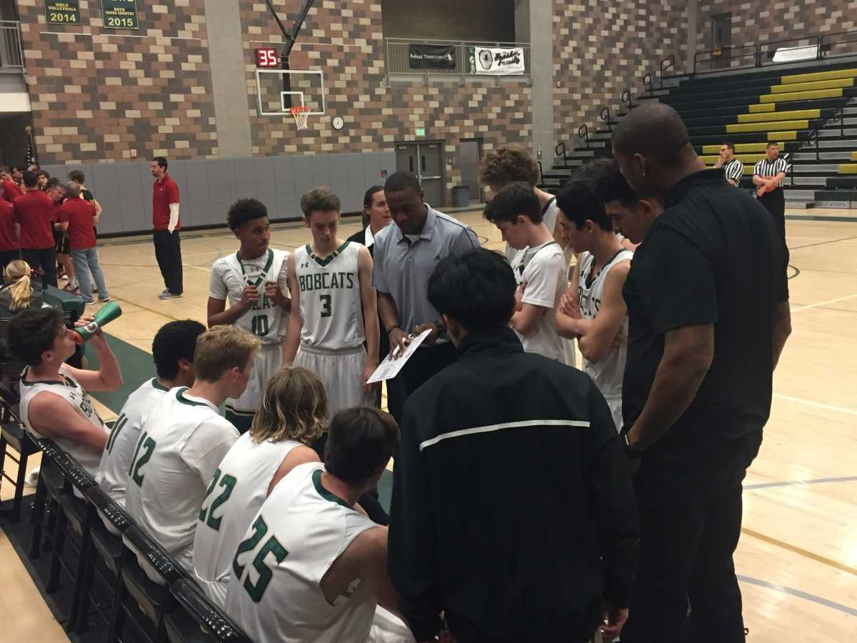 Coach Brandon Dowdy rallies his team in a meeting during a high scoring fourth quarter in the loss against Torrey Pines.