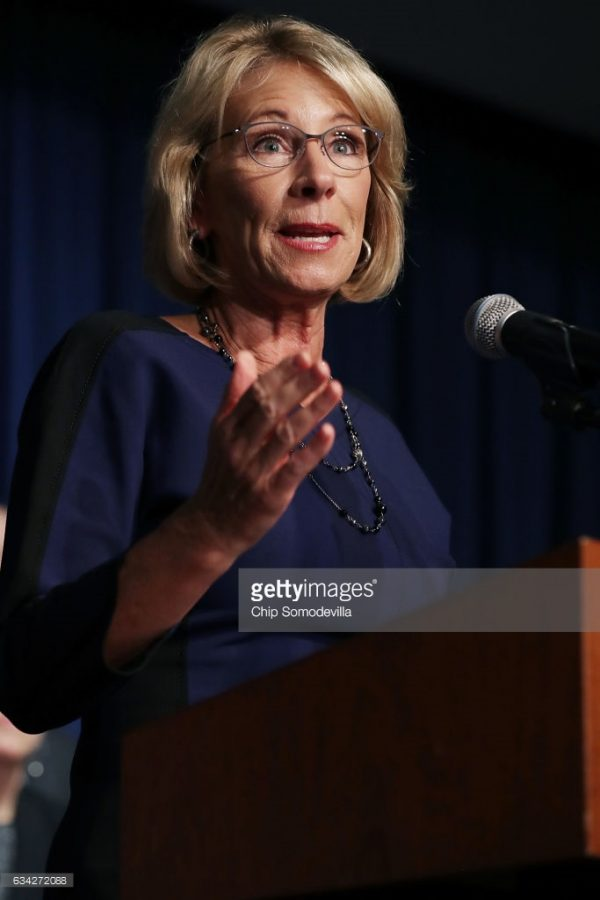 Betsy Devos answers questions during senate confirmation hearing.