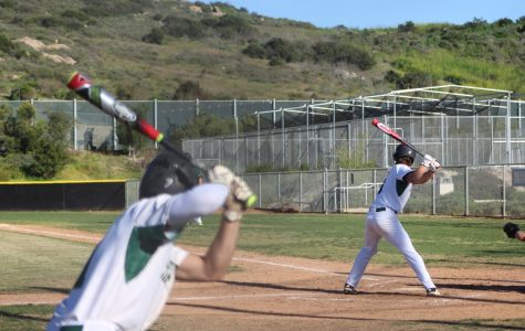 #7 senior Ryan Torres on deck preparing his swing for when he takes the plate.
