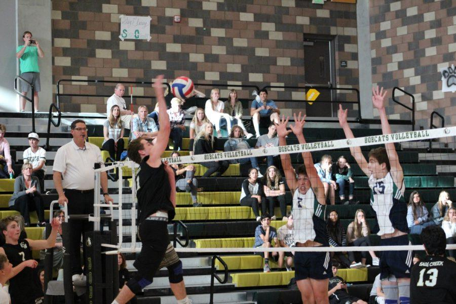 Outside hitter Christian Janke looks to tip the ball over the blockers for a kill.