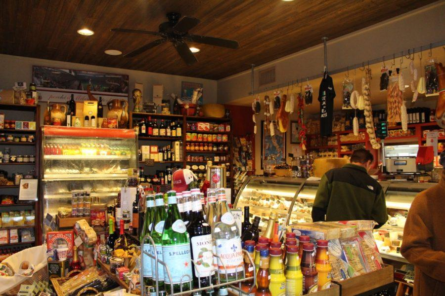 Bottles of Wine, boxes of chocolates, and bags of Italian chips scour the tiny market place, as customers walk in with a smile on their face from ear to ear.