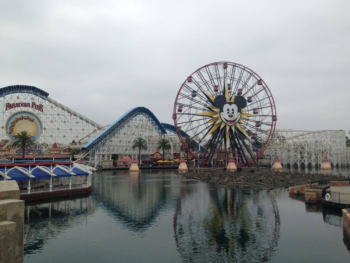 Mickey Mouse smiles out on as guests enter Disneyland and California Adventure