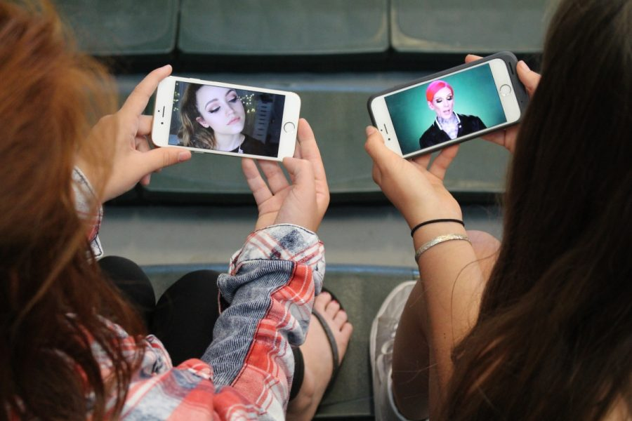 Sage Creek students observe the not-so-funny beauty vloggers on their phones during lunch.