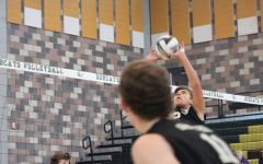 Junior setter Christian Griego looks to set a ¨go¨ to junior outside hitter Christian Janke.