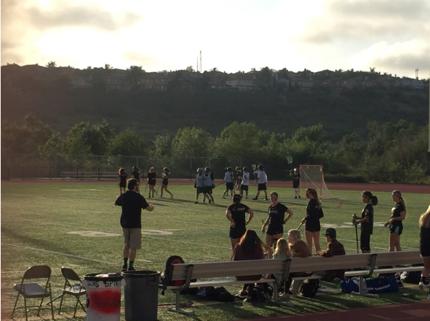 The Girls Varsity Lacrosse team watches on as play is stopped for a contact violation.