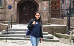 Elyse is pictured in a blue Yale pull over outside one of her future school's buildings. Photo Credit: Elyse VanderWoude