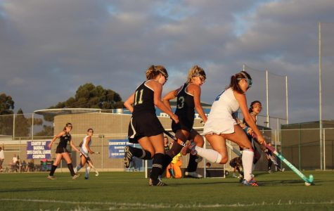 Sage Creek field hockey players defend La Jolla Country Day player.