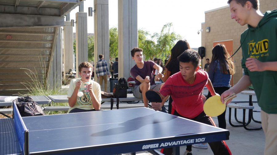 Fellow Bobcats participate in an intense ping pong match.