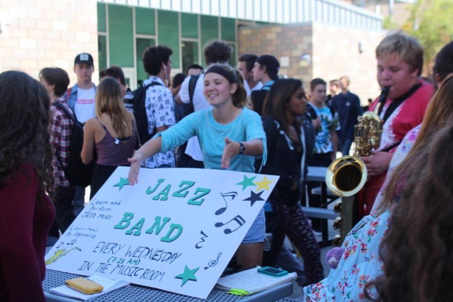 Senior Tessa Witkofsky promotes her Jazz Band club.