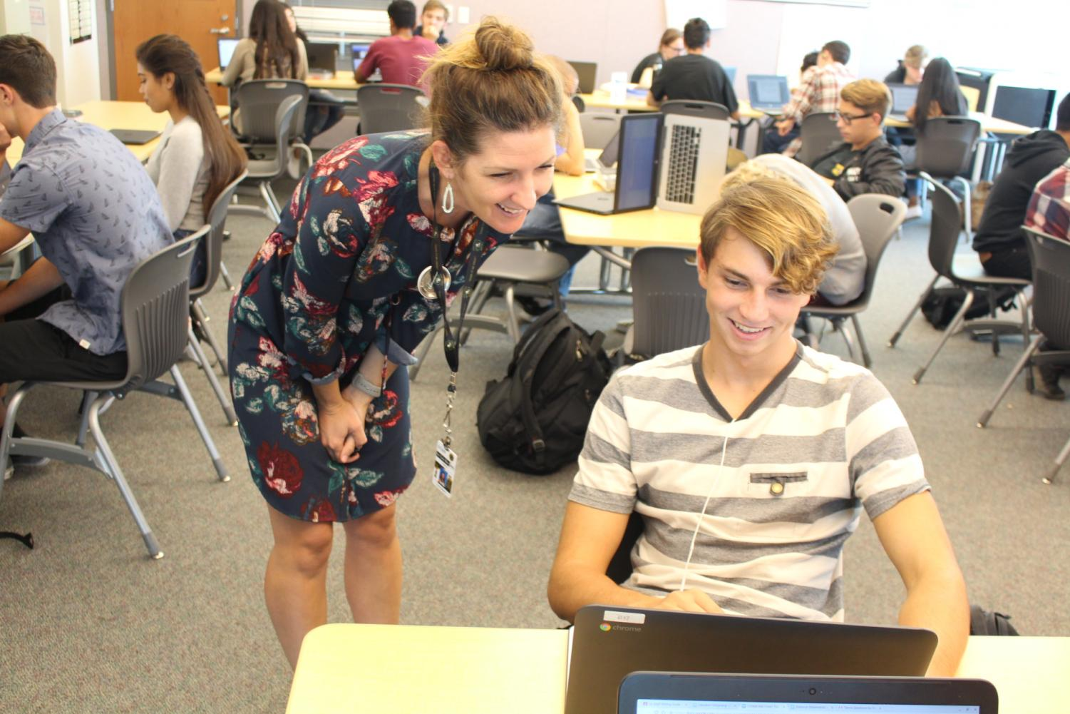 English teacher Corrie Myers helps a student revise his college application.