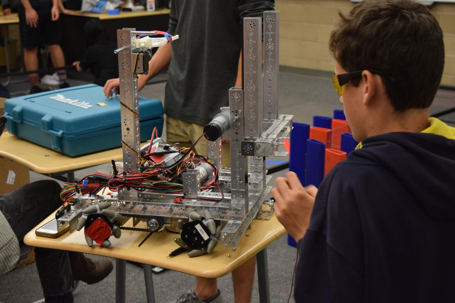 Robotics team member constructs for a future competition.