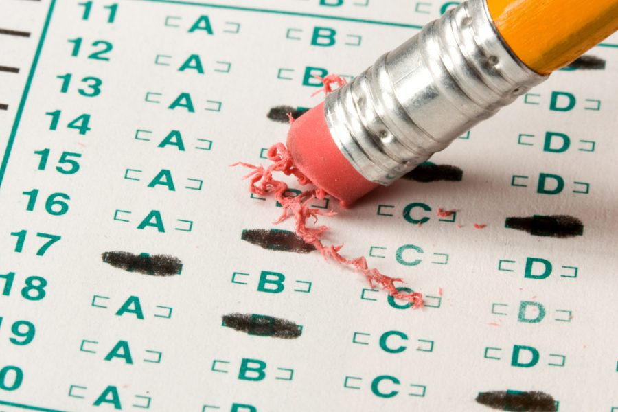 A student double checking their work on a standardized test.