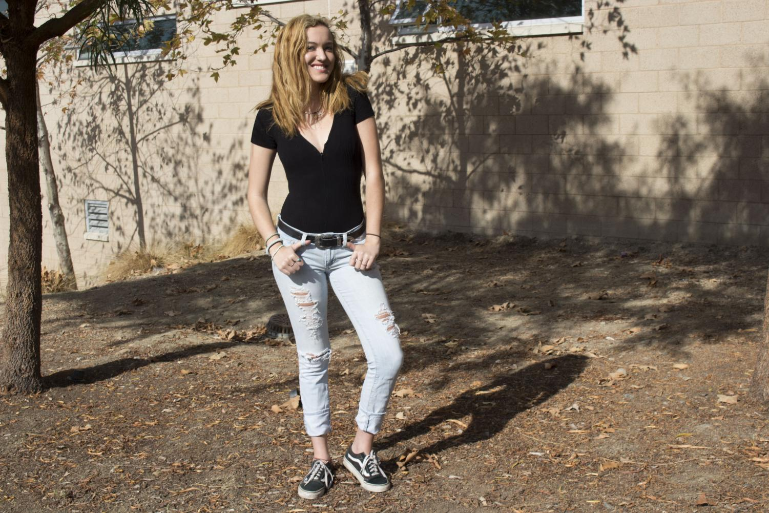 Senior+Charlotte+Dowson+pairs+a+classic+black+short+sleeve+v-neck+and+ripped+slim+light+wash+jeans.+She+enjoys+shopping+at+Urban%2C+Nordstrom%2C+Pacsun%2C+Madewell%2C+Supreme%2C+and+Brixton.