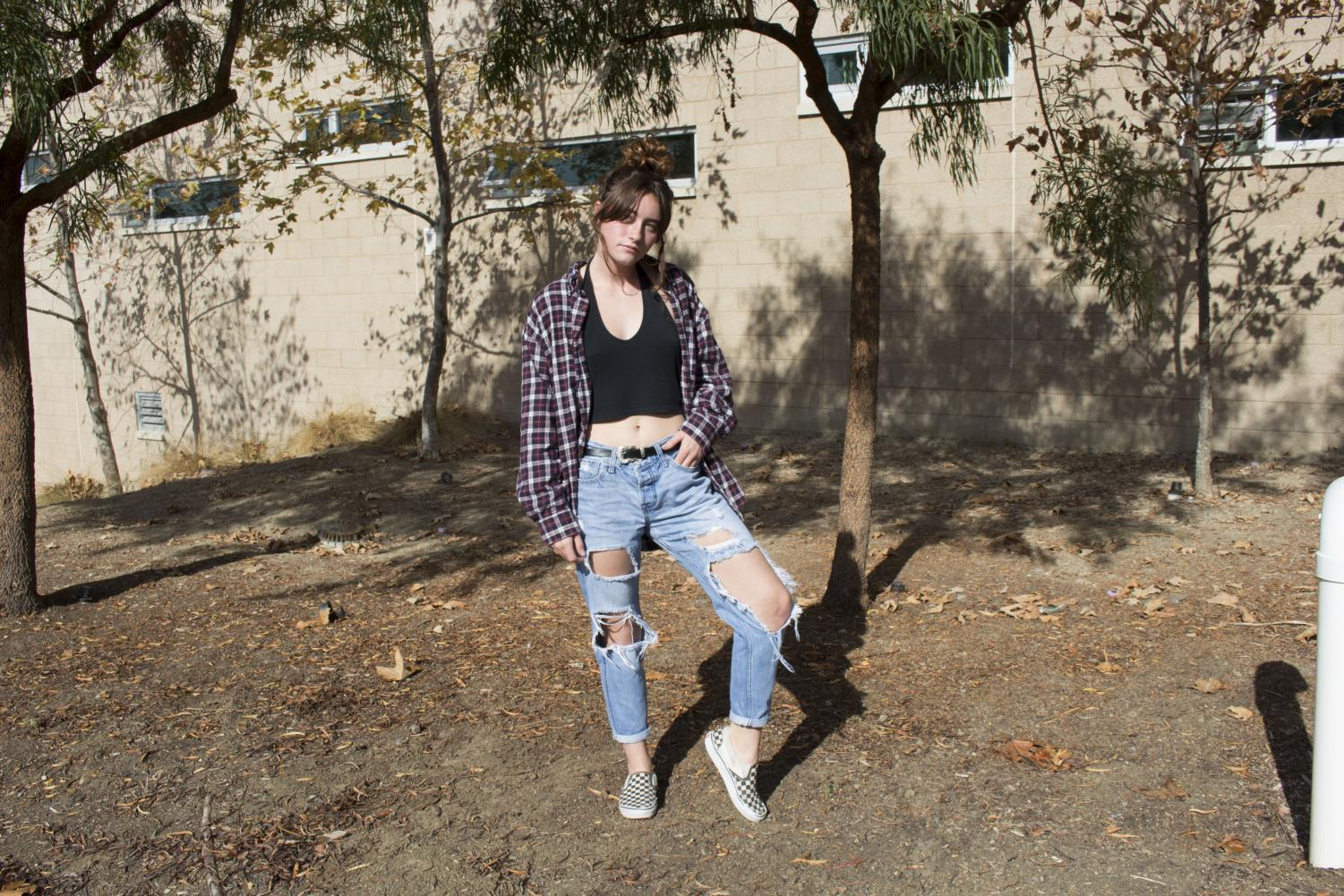 Junior+Madisyn+Goerlitz+rocks+ripped+boyfriend+jeans%2C+a+black+halter+crop+top%2C+a+loose+flannel%2C+and+tops+the+outfit+off+with+checkered+vans.+%E2%80%9CAlways+look+good+in+case+in+case+you+run+into+a+celebrity%2C%E2%80%9D+Madisyn+advises.