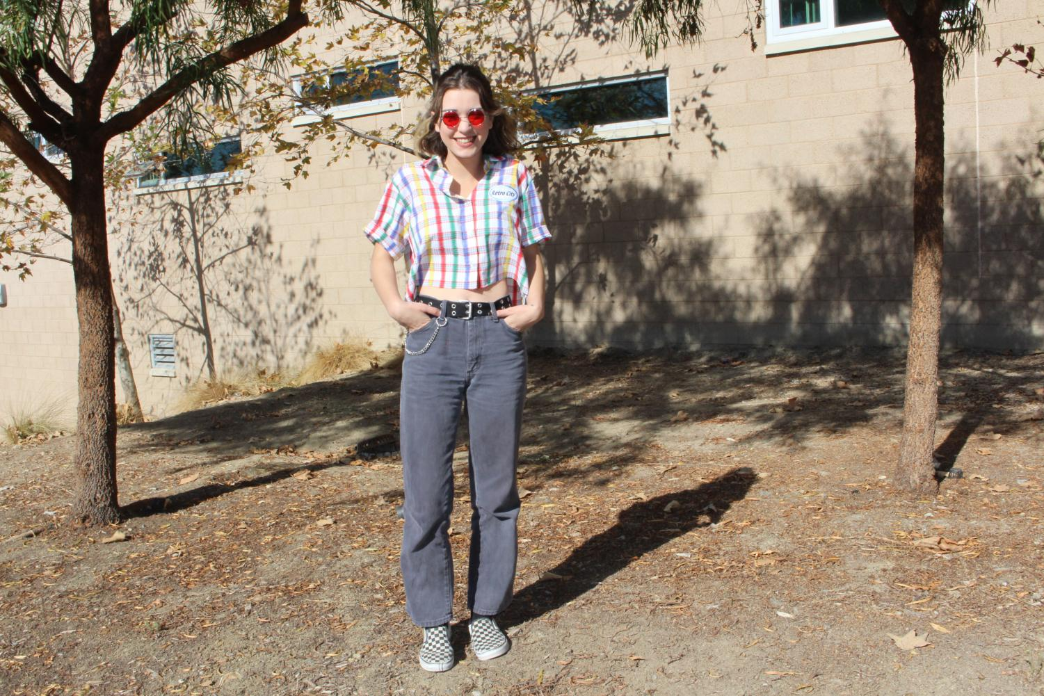 Junior+Skylar+Johnson+rocks+a+retro+colorful+button+down+that+she+ties+with+baggy+faded+blue+jeans.+She+adds+accessories+like+a+big+black+belt%2C+checkered+Vans%2C+red+old+school+glasses+and+a+silver+chain.+She+gets+the+majority+of+her+clothes+from+other+vendors+when+they+swap+back+and+forth+on+Depop.+Check+out+her+shop+on+Depop%21+https%3A%2F%2Fwww.depop.com%2Fscaryskylar