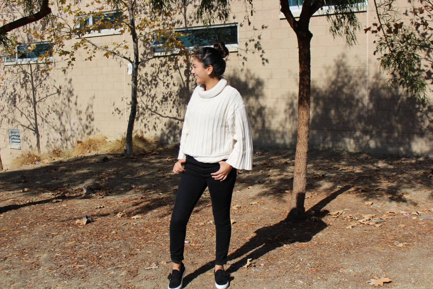 Senior+Sophia+Gonzalez+wears+an+intricately+designed+off-white+sweater+paired+and+dark+jeans.+With+her+hair+in+a+top-knot%2C+Gonzalez+is+ready+to+fight+the+upcoming+winter+weather.