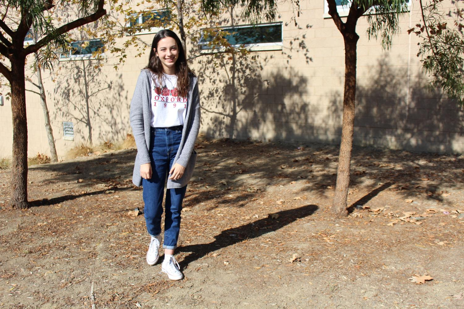 Sophomore+Sydney+Ahrendt%2C++expresses+her+cute+yet+comfortable+style+with+pieces+from+Urban+Outfitters+and+Nordstroms.+While+making+sure+to+avoid+clashing+patterns+Ahrendt+reminds+students+to+%C2%A8always+dress+comfortably.%22