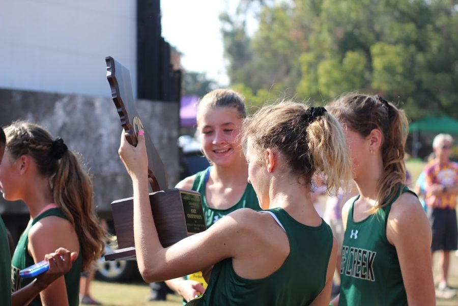 Elizabeth+Gerhardt+holds+the+second+place+trophy+for+the+CIF+state+cross+country+meet.+Gerhardt+came+in+39th+place+within+the+195+girls+in+her+league.+The+Sage+Creek+girls+cross+country+team+took+home+this+trophy+after+a+successful+season+full+of+accomplishments.%0A