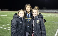 Bailee Brennan smiles excitedly with her fellow teammates after an imorpant team meeting discussing the moves they need to make to win CIF, before she goes off to UCSD to play D1 soccer.