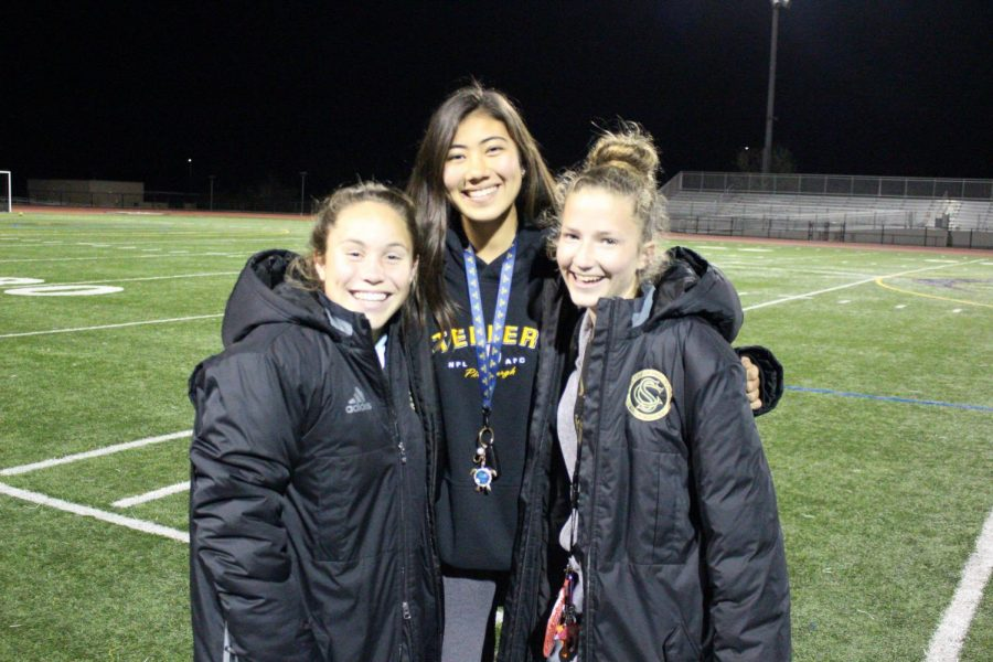 Bailee+Brennan+smiles+excitedly+with+her+fellow+teammates+after+an+imorpant+team+meeting+discussing+the+moves+they+need+to+make+to+win+CIF%2C+before+she+goes+off+to+UCSD+to+play+D1+soccer.%0A