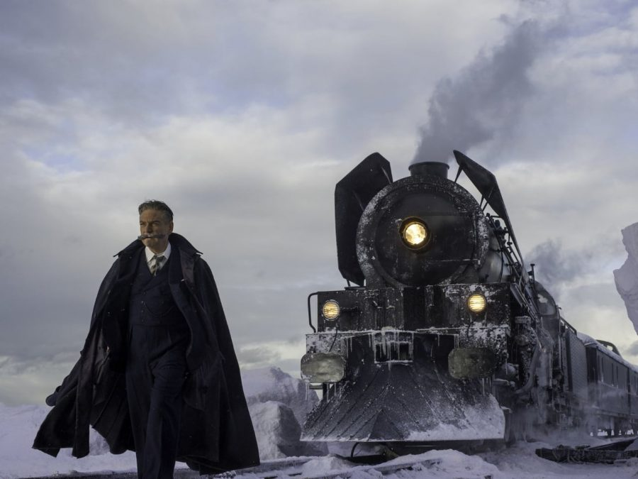 The main character, Hercule Poirot stands next to the train, attempting to solve a murder.