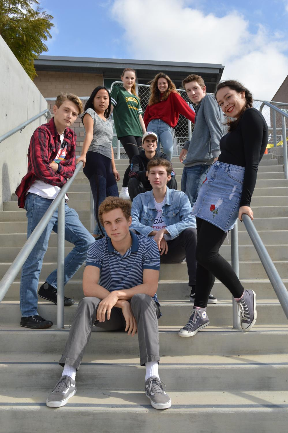 The nine senior directors of the 2018 Senior Directing Showcase pose dramatically on a staircase outside of the performing Arts Center. The directors worked on producing a scene for their project in which they had to pick, cut, cast, and direct before the showcase was performed for parents, peers, and theater lovers alike.