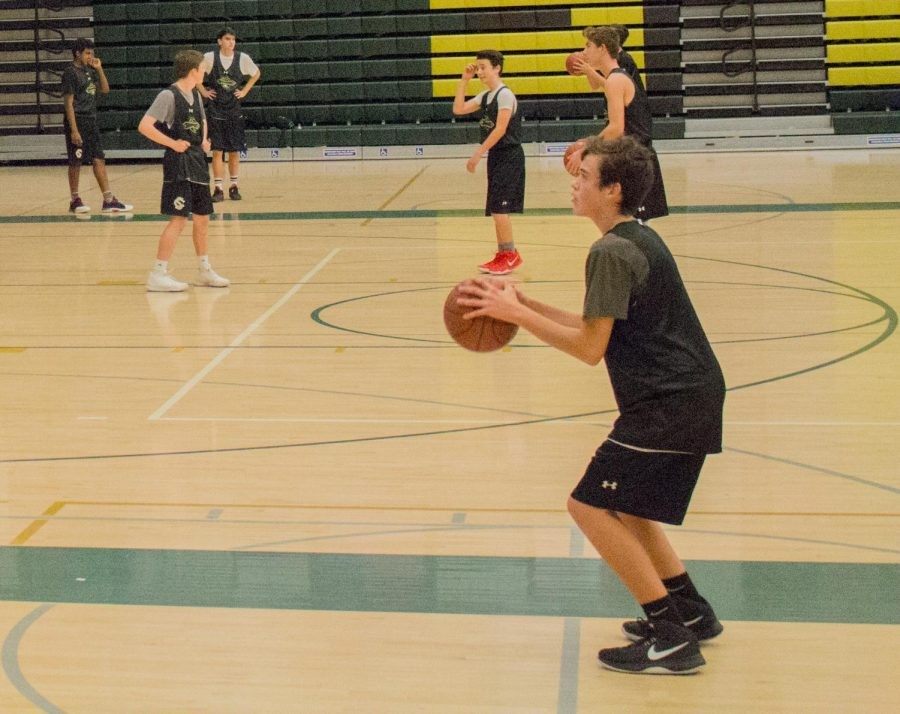 Freshman Gabe Arthur makes a free throw attempt during practice.