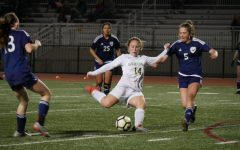 Silje Vigeland passes the ball down the field to the rest of the team trying to secure a point for Sage Creek.