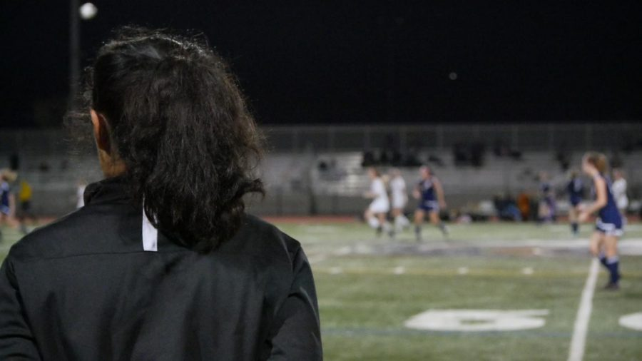 Jessica Rosas watches her players try desperately to take the lead.