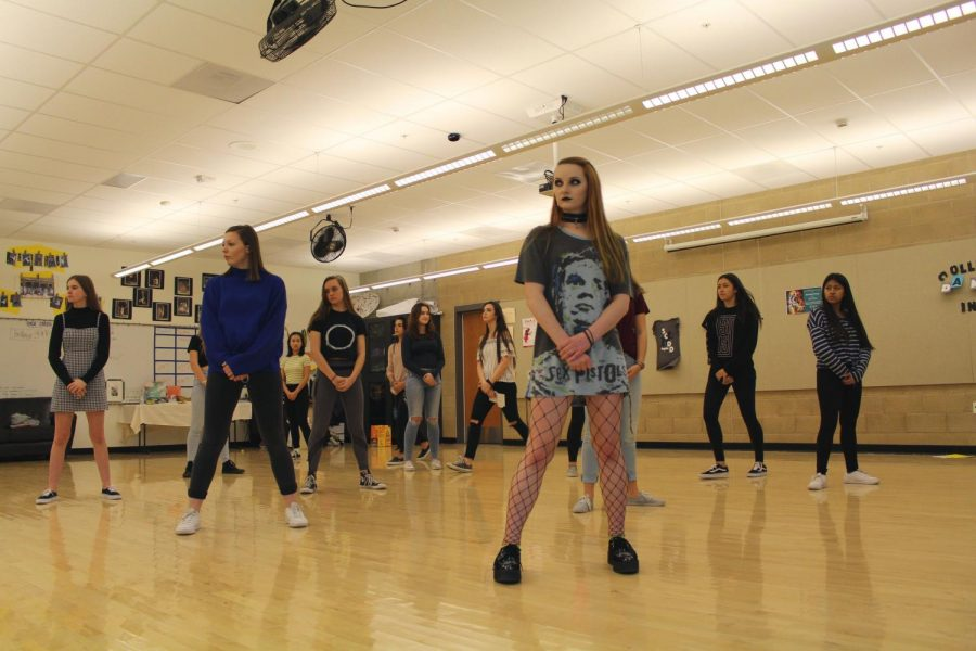 Senior Alex Morel practices a routine with the rest of the dance team during one of the team's daily after school practices. Morel is one of the three captains of the team.