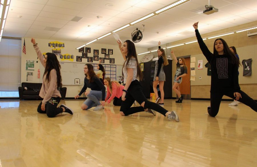 Dance team members practice a routine at one of their daily after school practices. The team performs often at Sage Creek school assemblies and at half time during sports games.