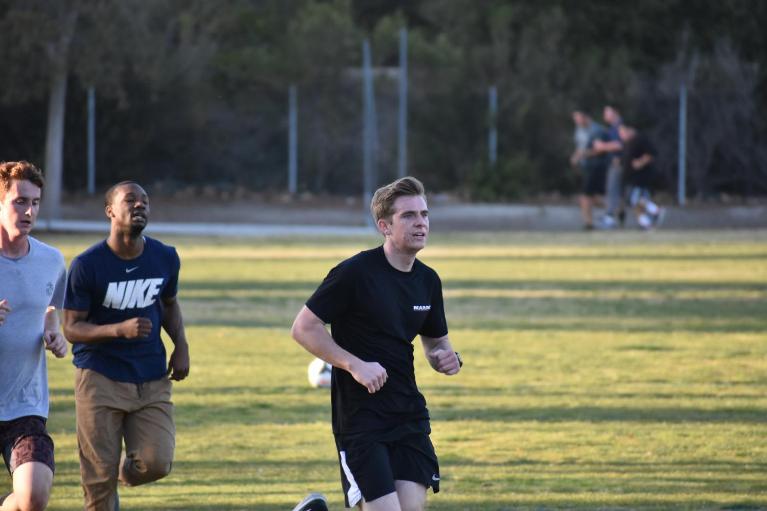Senior Grant Hughes finishes running a lap around the field. Recruits like Grant complete rigorous training to be eligible to serve.