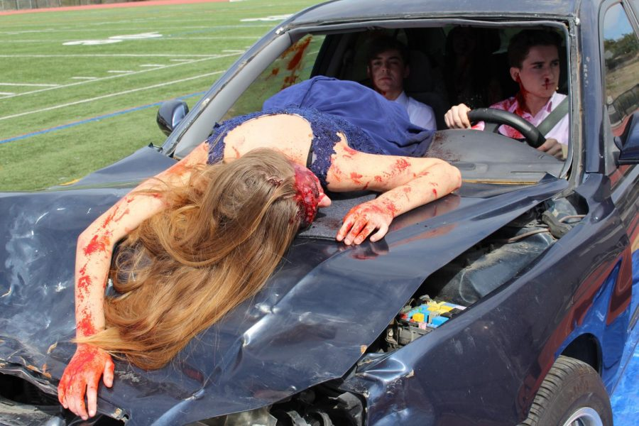 During the Every 15 Minutes two-day program, Junior Summer Fitzgerald unfortunately passed away in the simulation, and is displayed laying on the hood of the totalled vehicle.