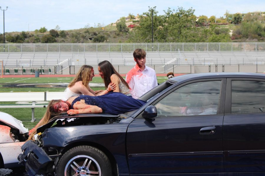 As seniors Lea Marquez and Jonathan Schlegel stumble out of the vehicle, they too join Paige Loeffler in grieving for what has happened in the scene.