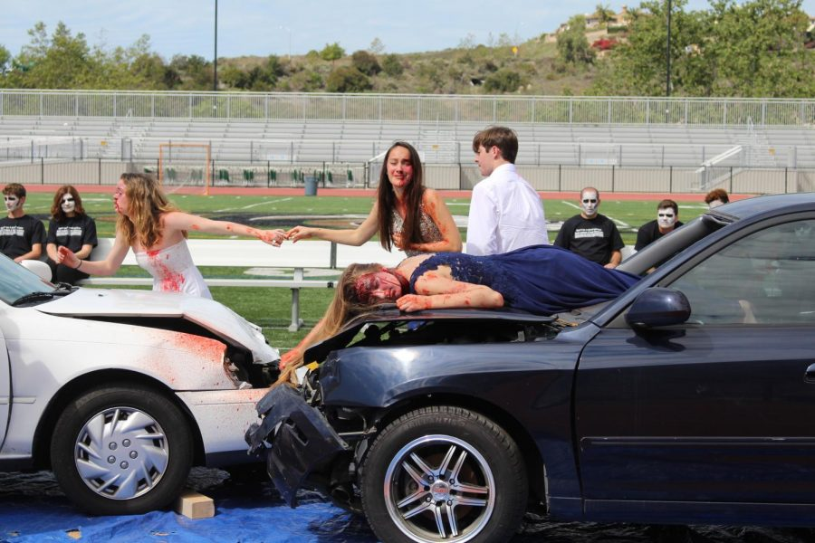 Senior Lea Marquez wallows in pain as she cries out for the loss of close friend, Summer Fitzgerald, in the crash scene on Tuesday.
