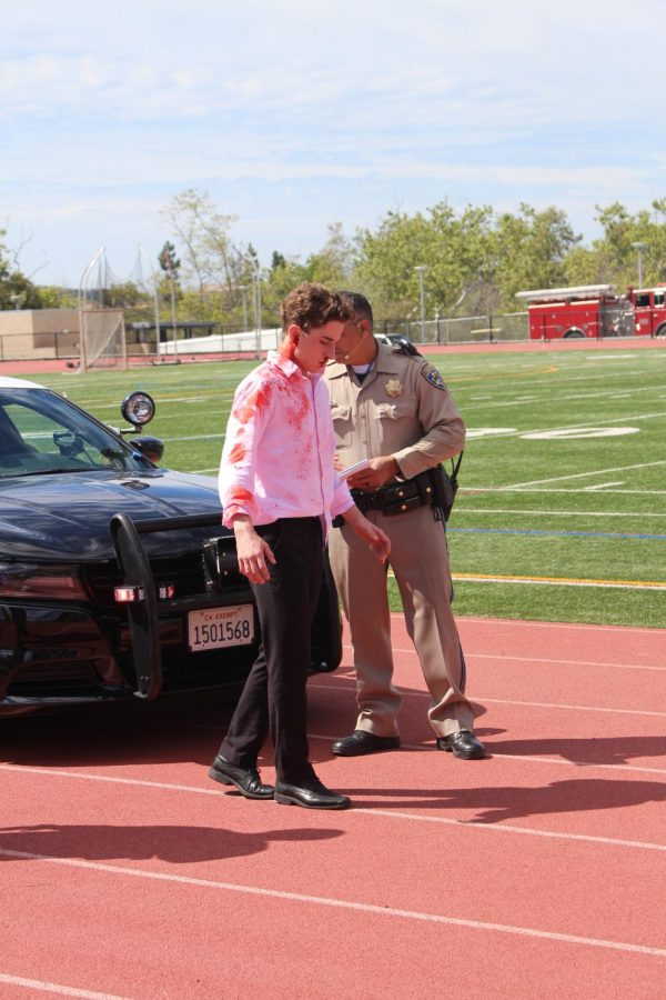 Senior Connor Tabone is seen being tested for driving under the influence during the Every 15 Minutes simulated incident.